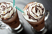 Refreshing iced coffe drink with whipped cream: freddoccino, frappuccino