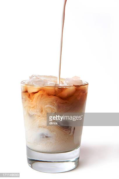 Iced Coffee with cream being poured in