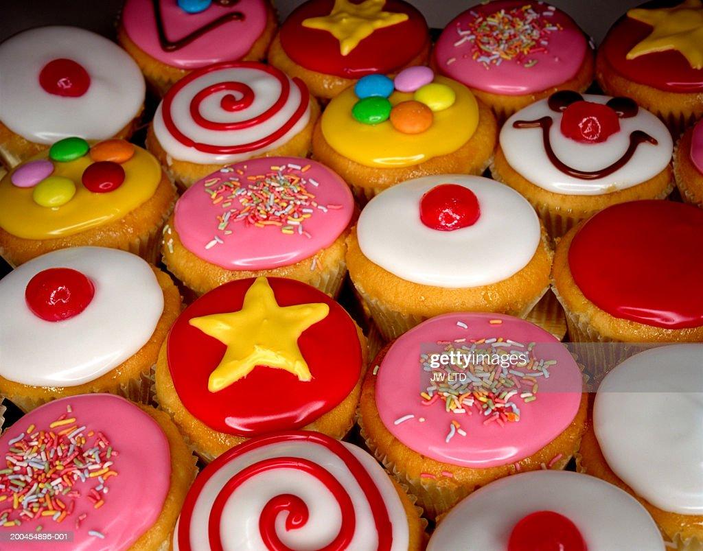 Iced cupcakes, close-up : Stock Photo