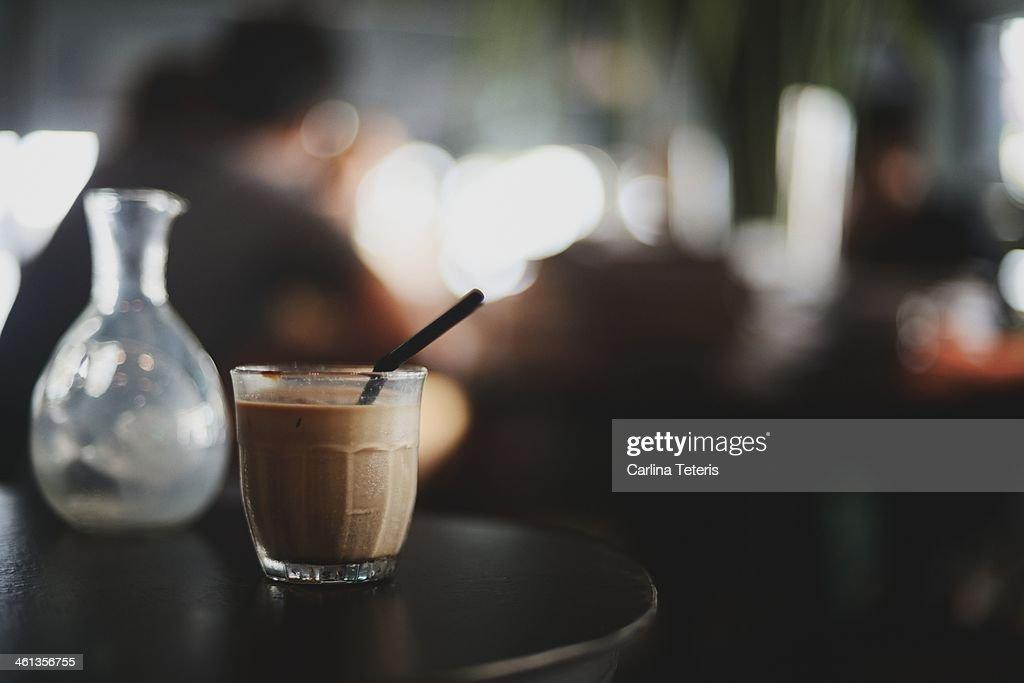 Iced espresso with a straw