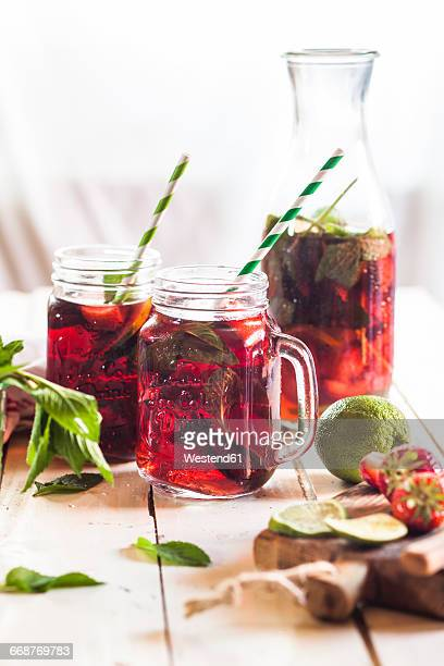 Iced tea with fruits, hibiscus, strawberries, mint, limes