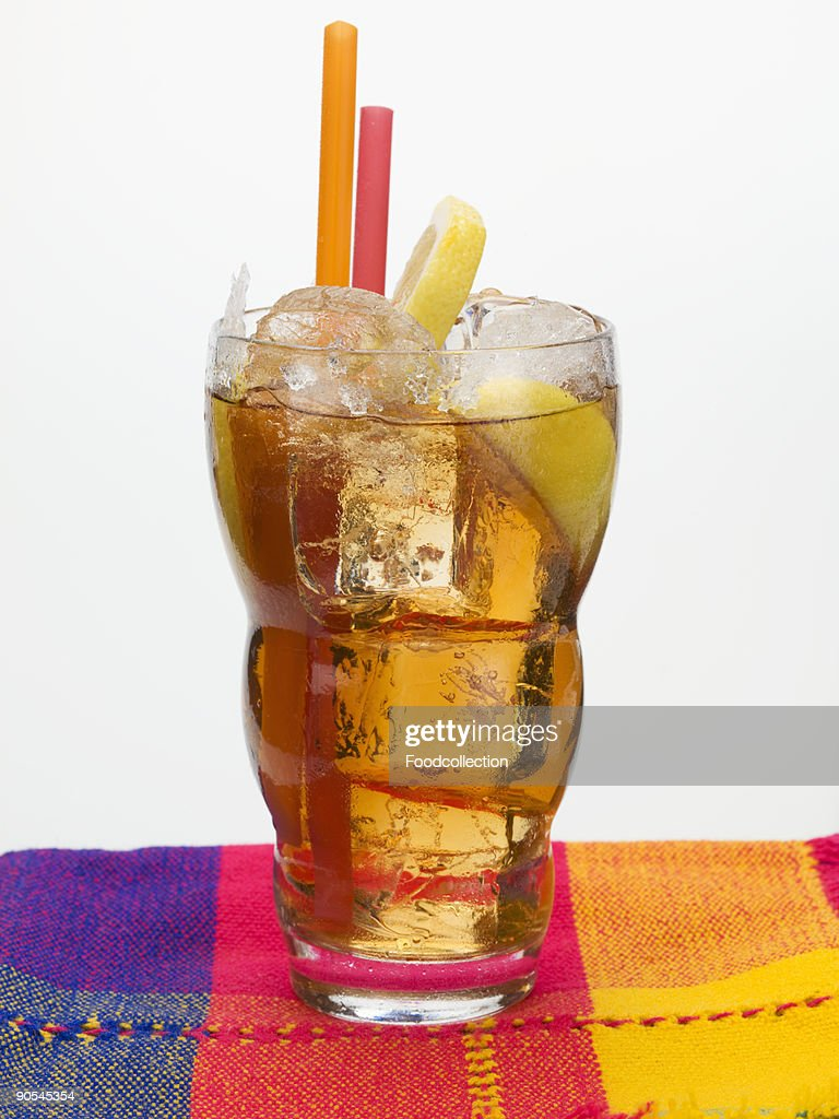Iced tea with ice cubes and lemon on napkin : Stock Photo
