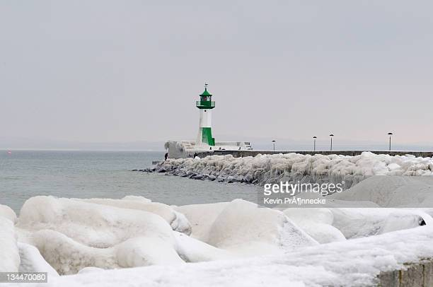 Iced wharf and a lighthouse in the port of Sassnitz on Ruegen Island, Mecklenburg-Western Pomerania, Germany, Europe