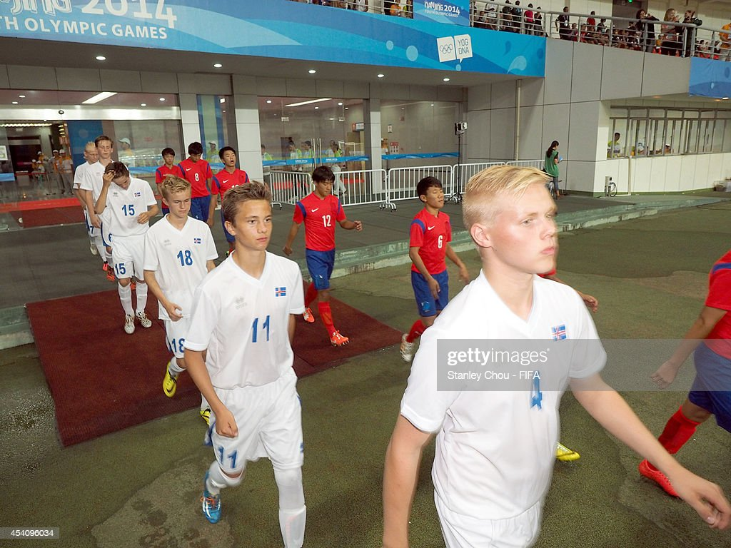 Iceland and Korea Republic enters prior to kick off during the 2014 FIFA Boys Summer Youth Olympic Football Tournament Semi Final match between Korea Republic and Iceland at Jiangning Sports Centre Stadium on August 24, 2014 in Nanjing, China.