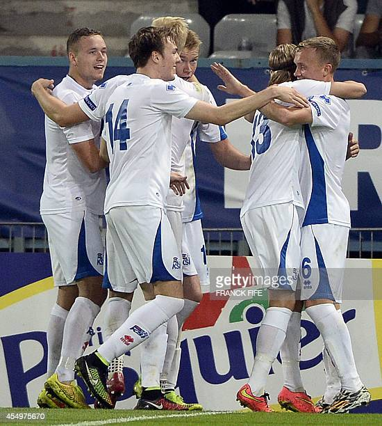 Iceland defender Kristjan Gauti Emilsson is congratuled by teammates after scoring a goal against France on September 8 2014 during the UEFA U21...