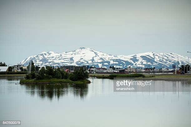 Iceland, Eyjafjordur, Akureyri, View of townscape with mountain in background