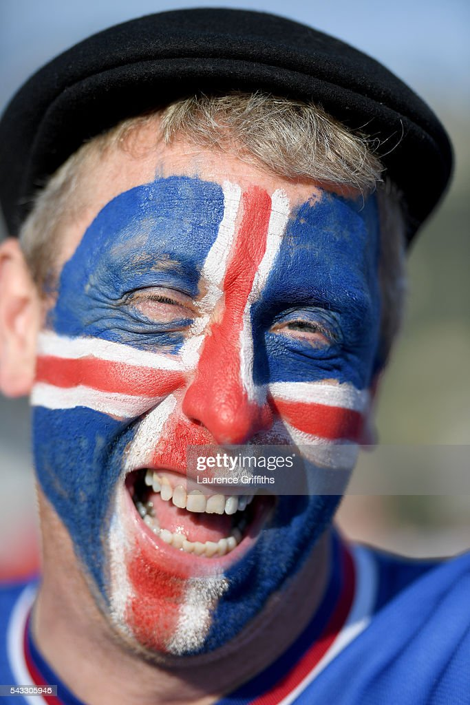 Iceland fan poses for photographs on his way to the stadium prior to the UEFA EURO 2016 round of 16 match between England and Iceland at Allianz Riviera Stadium on June 27, 2016 in Nice, France.