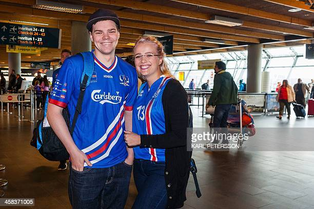 Iceland fans Sandra Karlsdottir and Johann Svavarsson react as they prepare to leave for France one day prior to the quater final Euro 2016 football...