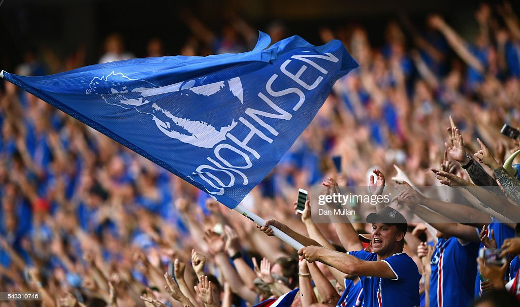 Iceland fans show their support with a flag bearing the name of Eidur Gudjohnsen prior to the UEFA EURO 2016 round of 16 match between England and Iceland at Allianz Riviera Stadium on June 27, 2016 in Nice, France.