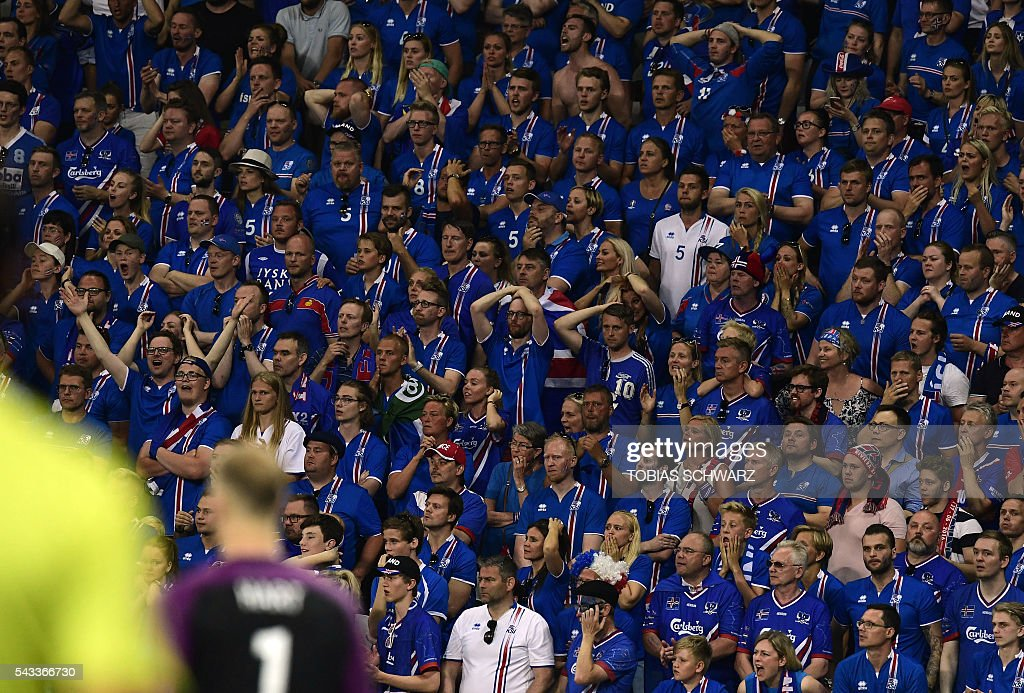Iceland fans watch the Euro 2016 round of 16 football match between England and Iceland at the Allianz Riviera stadium in Nice on June 27, 2016. / AFP / TOBIAS