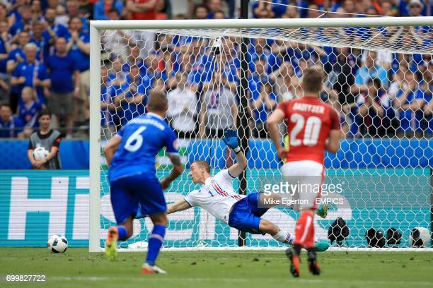 Iceland goalkeeper Hannes Thor Halldorsson watches Austria's Aleksandar Dragovic penalty kick hit the post and go wide