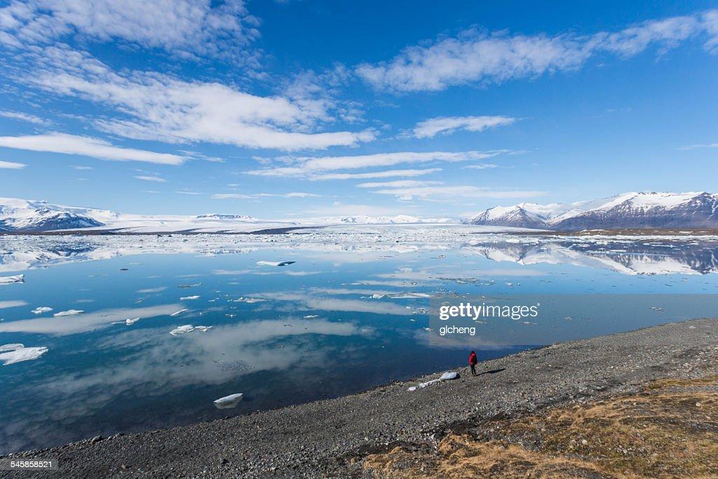 Iceland, Jokulsarlon lagoon, Woman looking at glaciers