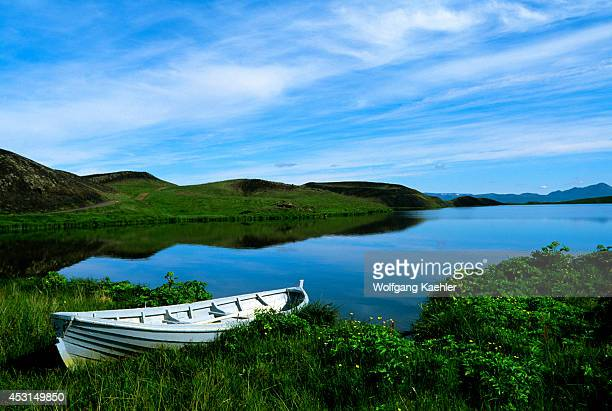 Iceland Myvatn Lake Boat With Pseudo Craters In Background