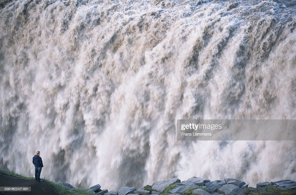 Iceland, Myvatn, man by Dettifoss waterfall : Stock Photo