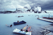 Iceland, people on air beds in the Blue Lagoon