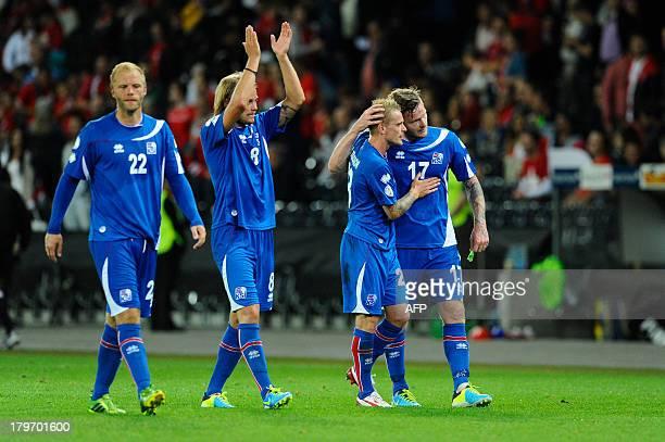 Iceland players Birkir Bjarnason Bikir Saevarsson and Aaron Gunnarsson celebrate at the end of the FIFA World Cup 2014 qualifying football match...