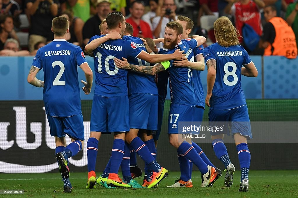 Iceland players celebrate their second goal during Euro 2016 round of 16 football match between England and Iceland at the Allianz Riviera stadium in Nice on June 27, 2016. / AFP / PAUL