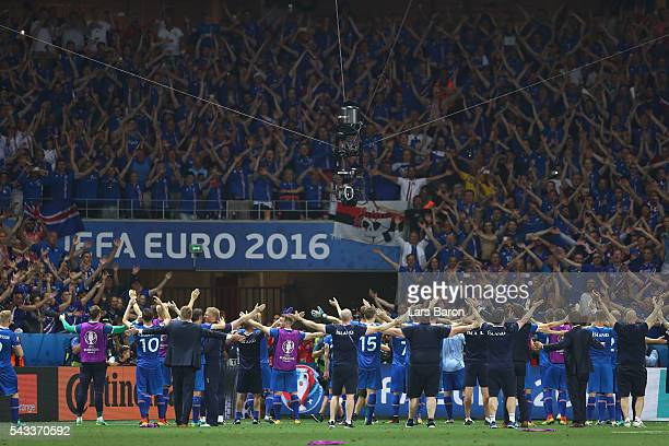 Iceland players celebrate their team's 21 win in front of the supporters after the UEFA EURO 2016 round of 16 match between England and Iceland at...