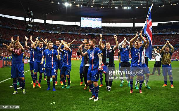 Iceland players celebrate victory in the UEFA EURO 2016 Group F match between Iceland and Austria at Stade de France on June 22 2016 in Paris France