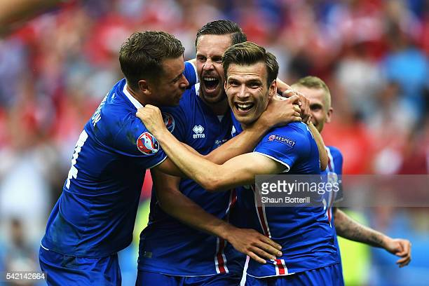 Iceland players celebrate winning the UEFA EURO 2016 Group F match between Iceland and Austria at Stade de France on June 22 2016 in Paris France