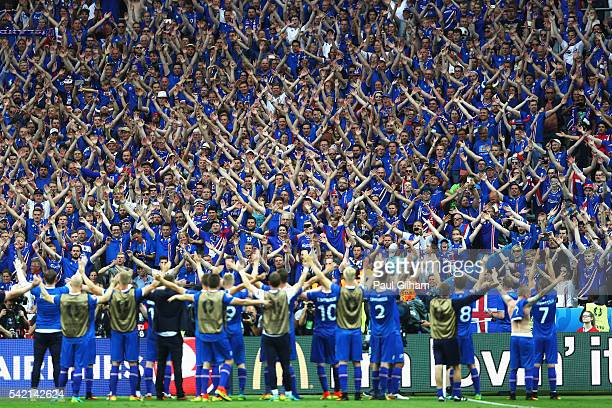 Iceland players celebrate with their fans after victory in the UEFA EURO 2016 Group F match between Iceland and Austria at Stade de France on June 22...