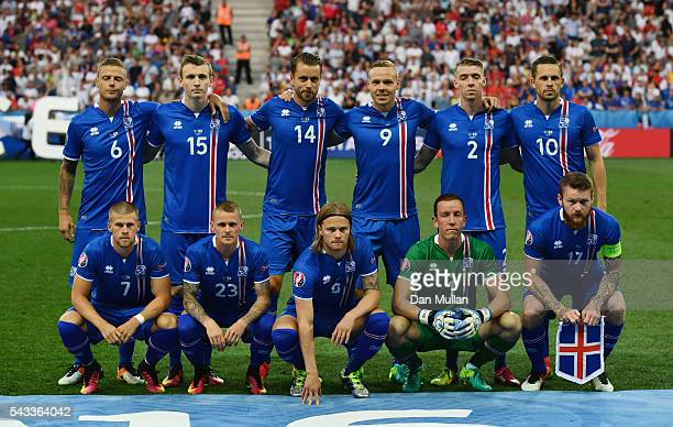 Iceland players line up for the team photos prior to the UEFA EURO 2016 round of 16 match between England and Iceland at Allianz Riviera Stadium on...