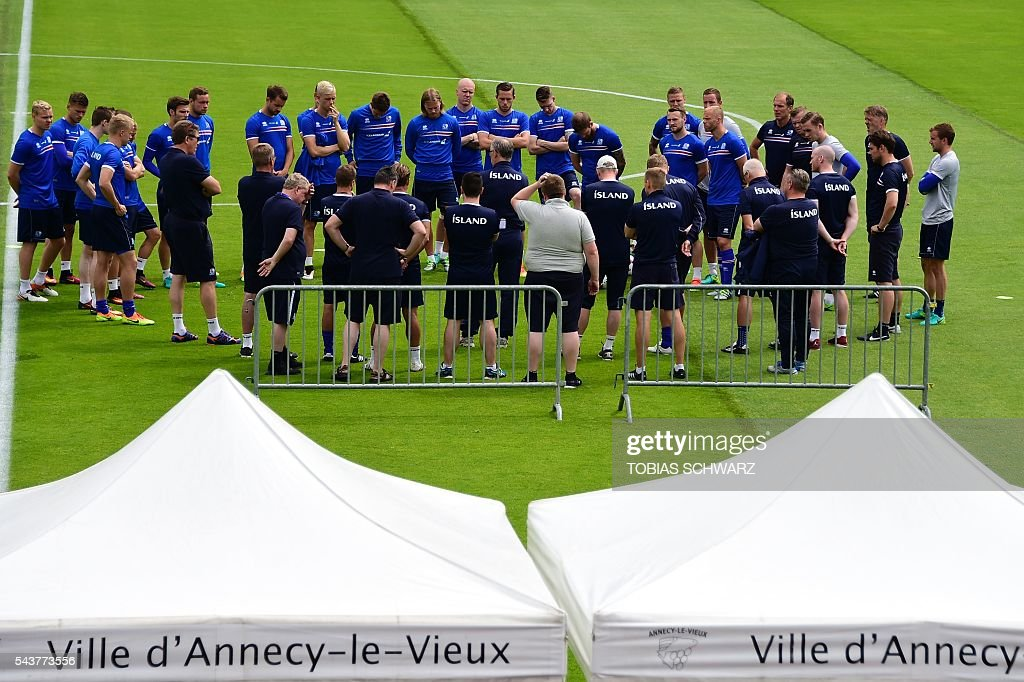 Iceland players listen to their coaches as they take part in a training session in Annecy on June 30, 2016, prior to their quarter-finals match against France on July 3 . / AFP / TOBIAS
