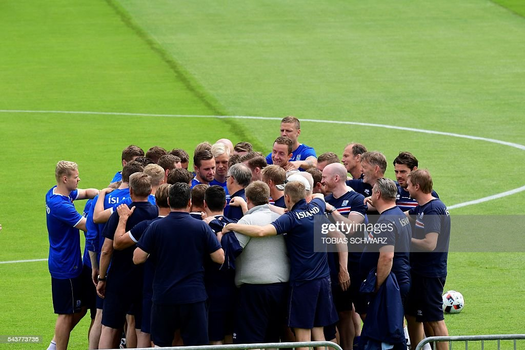 Iceland players listen to their coaches Iceland's coach Lars Lagerbaeck (C) and Iceland's coach Heimir Hallgrimssonas they take part in a training session in Annecy on June 30, 2016, prior to their quarter-finals match against France on July 3. / AFP / TOBIAS