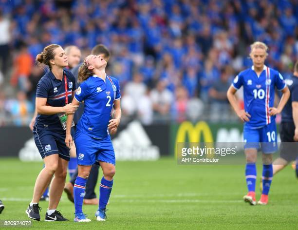 Iceland players react after losing the UEFA Womens Euro 2017 football tournament match between Iceland and Switzerland at Stadion De Vijverberg in...