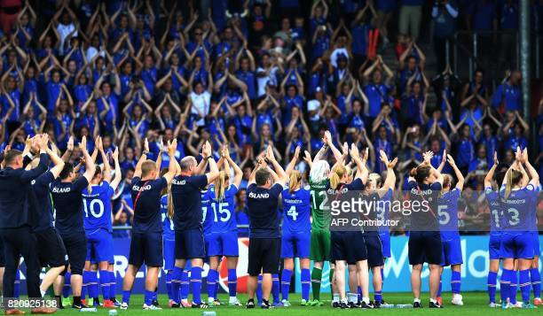 Iceland players share a slapping with fans after losing the UEFA Womens Euro 2017 football tournament match between Iceland and Switzerland at...