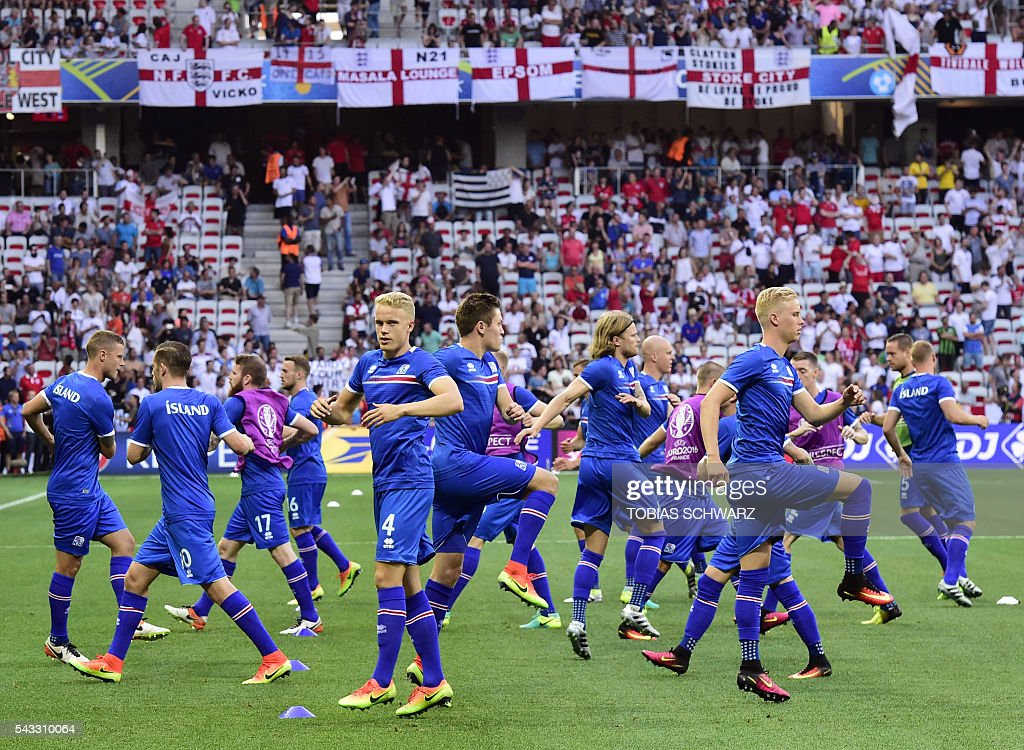Iceland players warm up prior to the start of the start of the Euro 2016 round of 16 football match between England and Iceland at the Allianz Riviera stadium in Nice on June 27, 2016. / AFP / TOBIAS