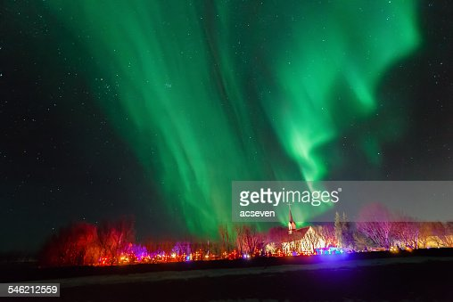 Iceland, Reykjavik, Aurora borealis over church