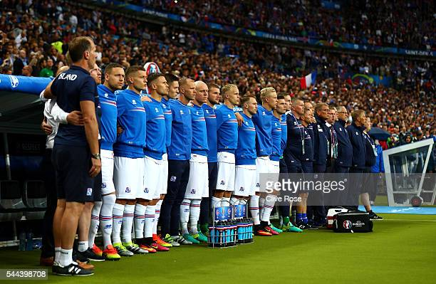 Iceland substitute players and team staffs line up for the national anthem prior to the UEFA EURO 2016 quarter final match between France and Iceland...