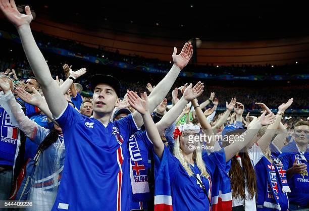 Iceland supporters applaud their players after the UEFA EURO 2016 quarter final match between France and Iceland at Stade de France on July 3 2016 in...
