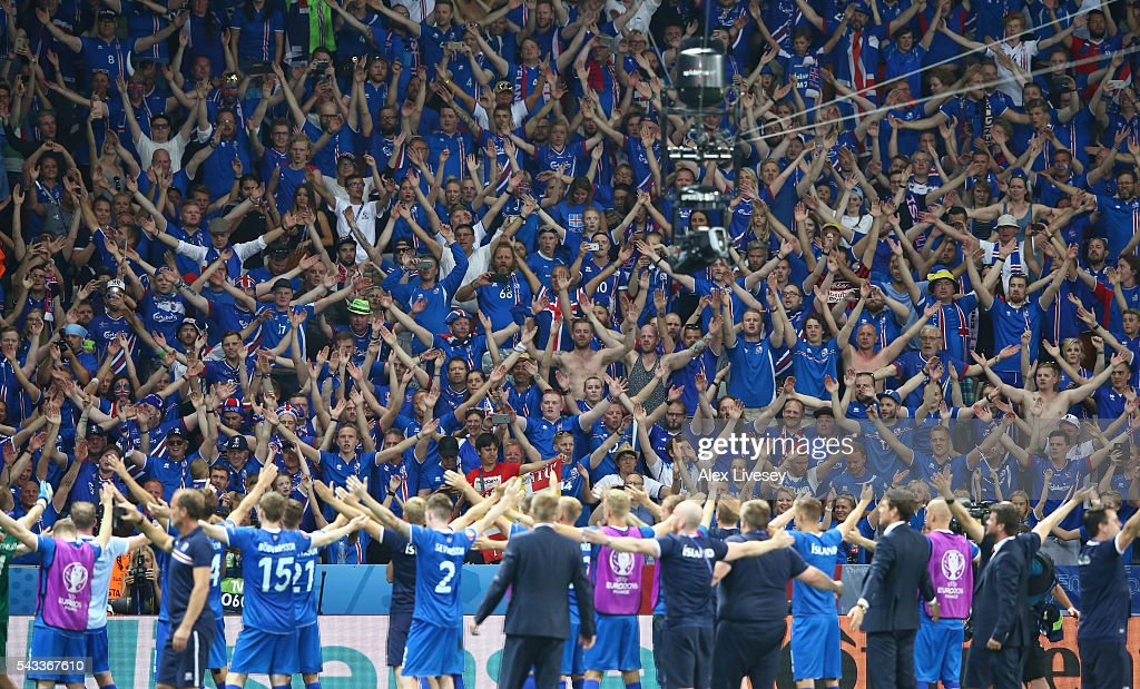 Iceland supporters celebrate their team's 2-1 win after the UEFA EURO 2016 round of 16 match between England and Iceland at Allianz Riviera Stadium on June 27, 2016 in Nice, France.