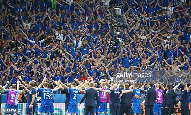Iceland supporters celebrate their team's 21 win after the UEFA EURO 2016 round of 16 match between England and Iceland at Allianz Riviera Stadium on...