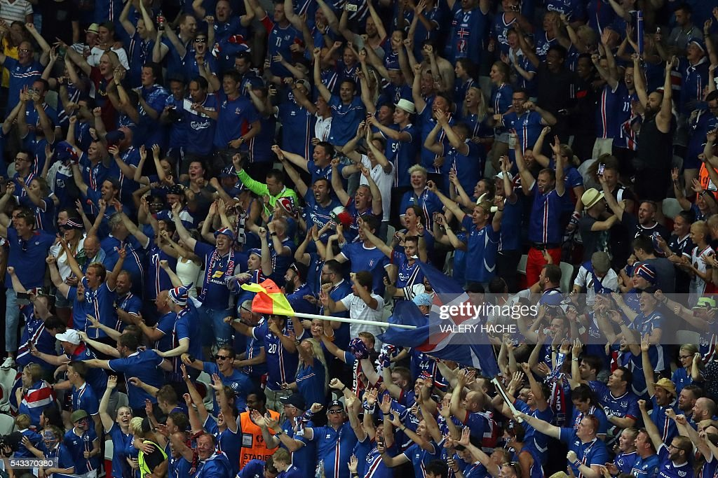 Iceland supporters celebrate their team's win after the Euro 2016 round of 16 football match between England and Iceland at the Allianz Riviera stadium in Nice on June 27, 2016. Iceland won the match 1-2. / AFP / Valery HACHE