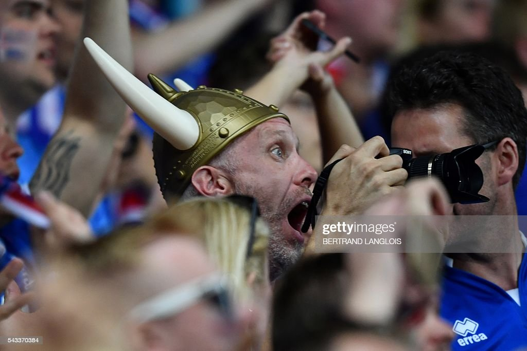 Iceland supporters celebrate their team's win after the Euro 2016 round of 16 football match between England and Iceland at the Allianz Riviera stadium in Nice on June 27, 2016. Iceland won the match 1-2. / AFP / BERTRAND