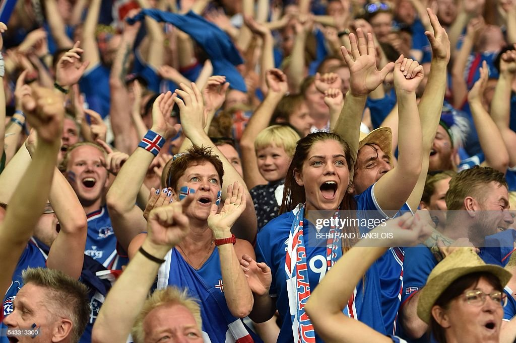 Iceland supporters cheer after a goal of their team during the Euro 2016 round of 16 football match between England and Iceland at the Allianz Riviera stadium in Nice on June 27, 2016. / AFP / BERTRAND
