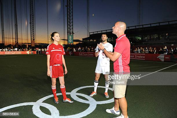 Icelandic fashion model Sigrun Eva Jonsdottir and Actor Josh Bowman participate in the cointoss prior to the Audi Player Index PickUp Match at...