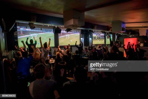 TOPSHOT Icelandic football fans react while watching TV their national football team play during the FIFA World Cup 2018 qualification football match...