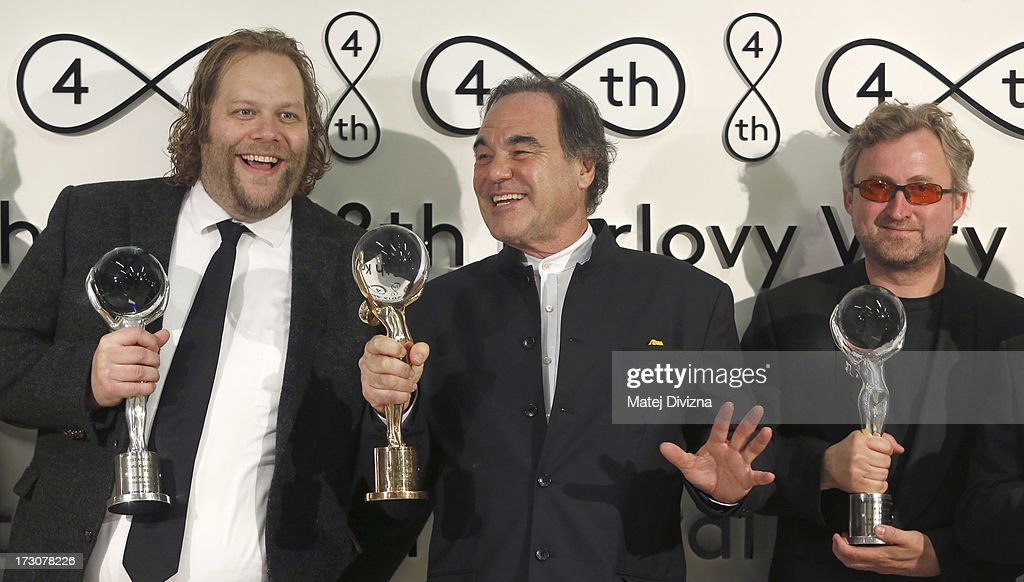 Icelandic Olafur Darri Olafsson, American director <a gi-track='captionPersonalityLinkClicked' href=/galleries/search?phrase=Oliver+Stone&family=editorial&specificpeople=173458 ng-click='$event.stopPropagation()'>Oliver Stone</a> and Czech director Jan Hrebejk pose with the Crystal Globes after the closing ceremony of the 48th Karlovy Vary International Film Festival (KVIFF) on July 06, 2013 in Karlovy Vary, Czech Republic.