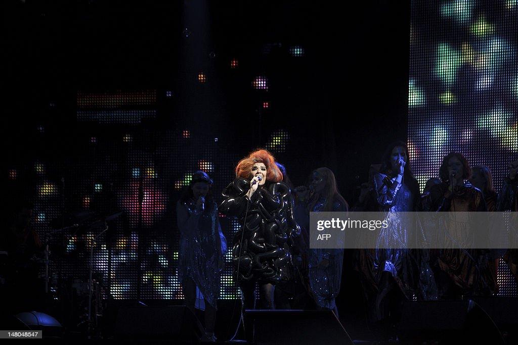 Icelandic singer Bjork (C) performs at the Roskilde Festival in Roskilde on July 8, 2012.