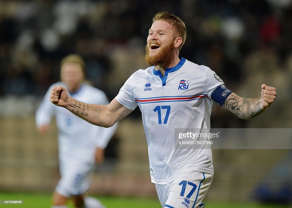 Iceland's Aron Gunnarsson celebrate after scoring during their Euro 2016 qualifier football match Latvia vs Iceland in Riga on October 10 2014 AFP...