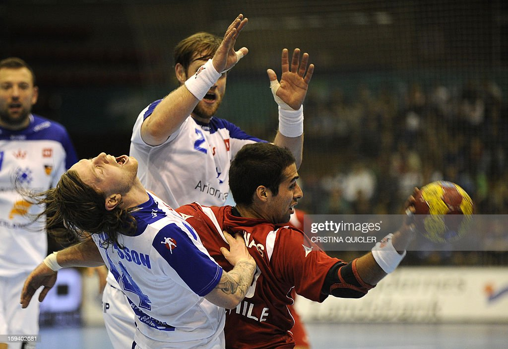 Iceland's back Arnor Gunnarsson (L) vies with Chile's centreback Esteban Salinas (R) during the 23rd Men's Handball World Championships preliminary round Group B match Chile vs Iceland at the Palacio de Deportes San Pablo in Sevilla on January 13, 2013.