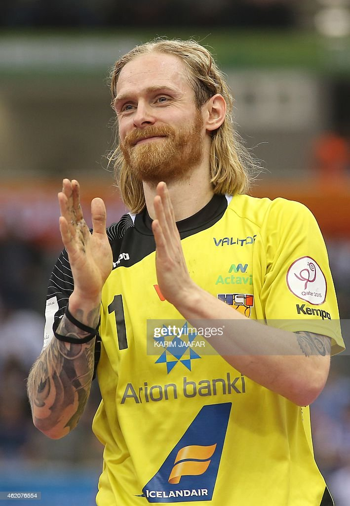 Iceland's Bjorgvin Pall Gustavsson celebrates after winning the 24th Men's Handball World Championships preliminary round Group C match against Egypt at the Ali Bin Hamad al-Attiya Arena in Doha on January 24, 2015.