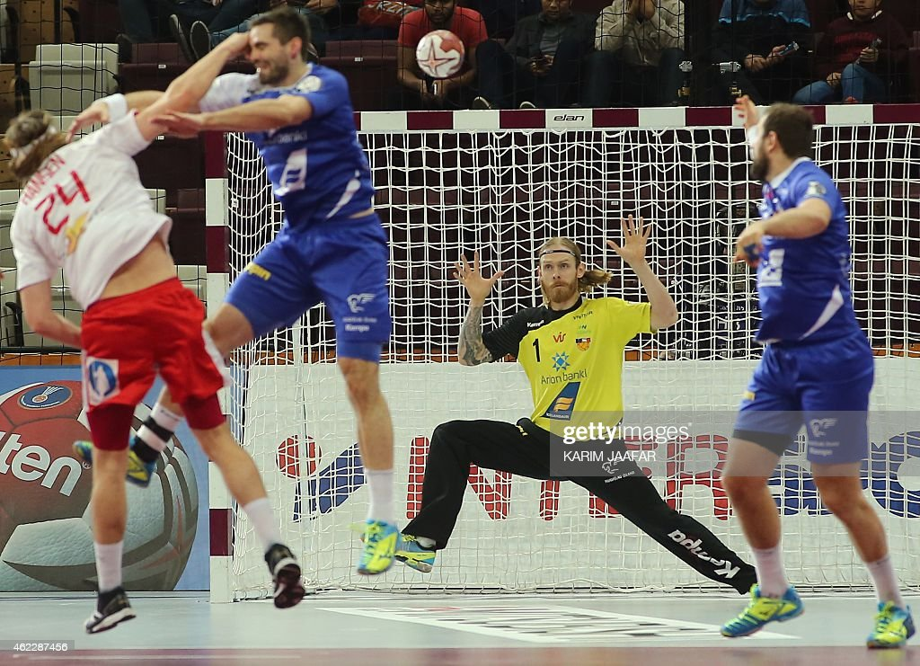 Iceland's Bjorgvin Pall Gustavsson (C) tries to save a goal during the 24th Men's Handball World Championships Eighth Final EF5 match between Iceland and Denmark at the Lusail Multipurpose Hall in Doha on January 26, 2015.