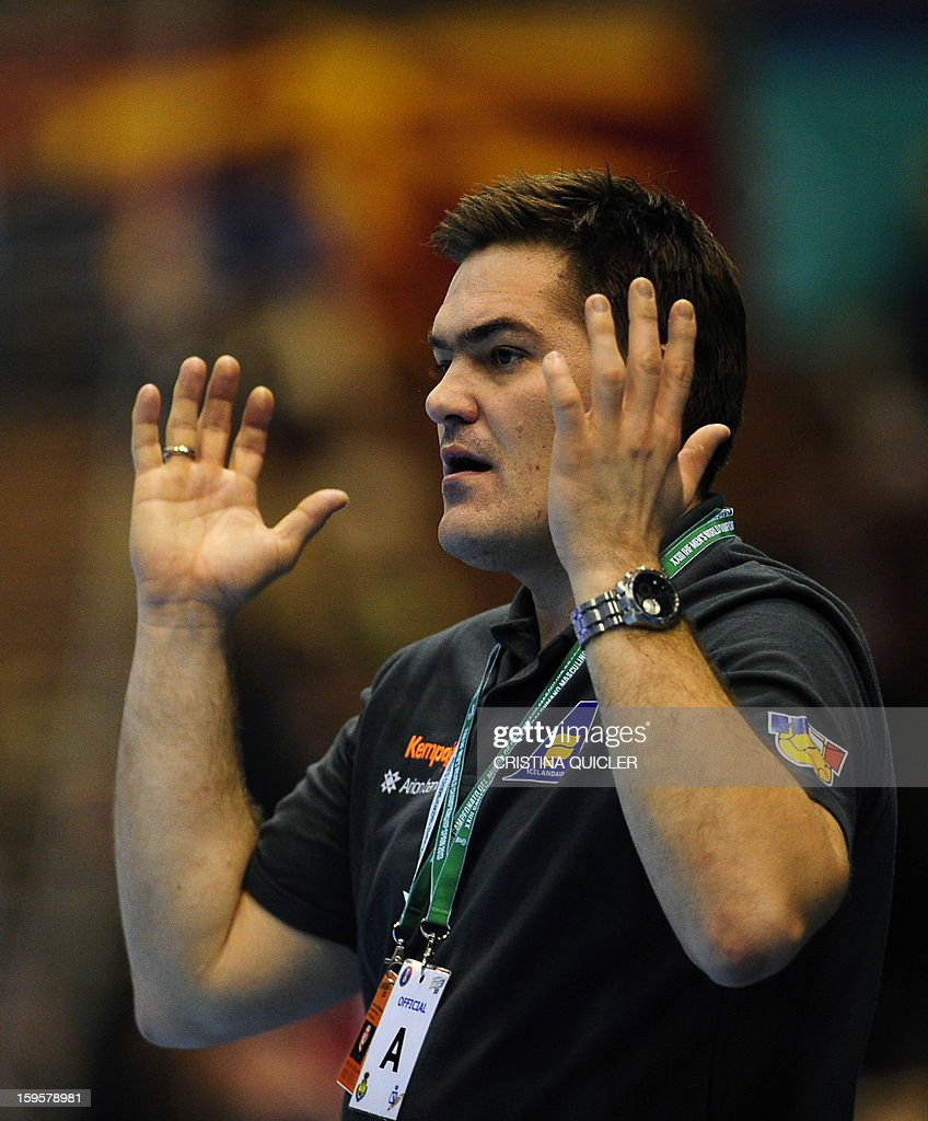 Iceland's coach Aron Kristjansson reacts during the 23rd Men's Handball World Championships preliminary round Group B match Iceland vs Denmark at the Palacio de Deportes San Pablo in Sevilla on January 16, 2013. Denmark won 28-36.AFP PHOTO/ CRISTINA QUICLER