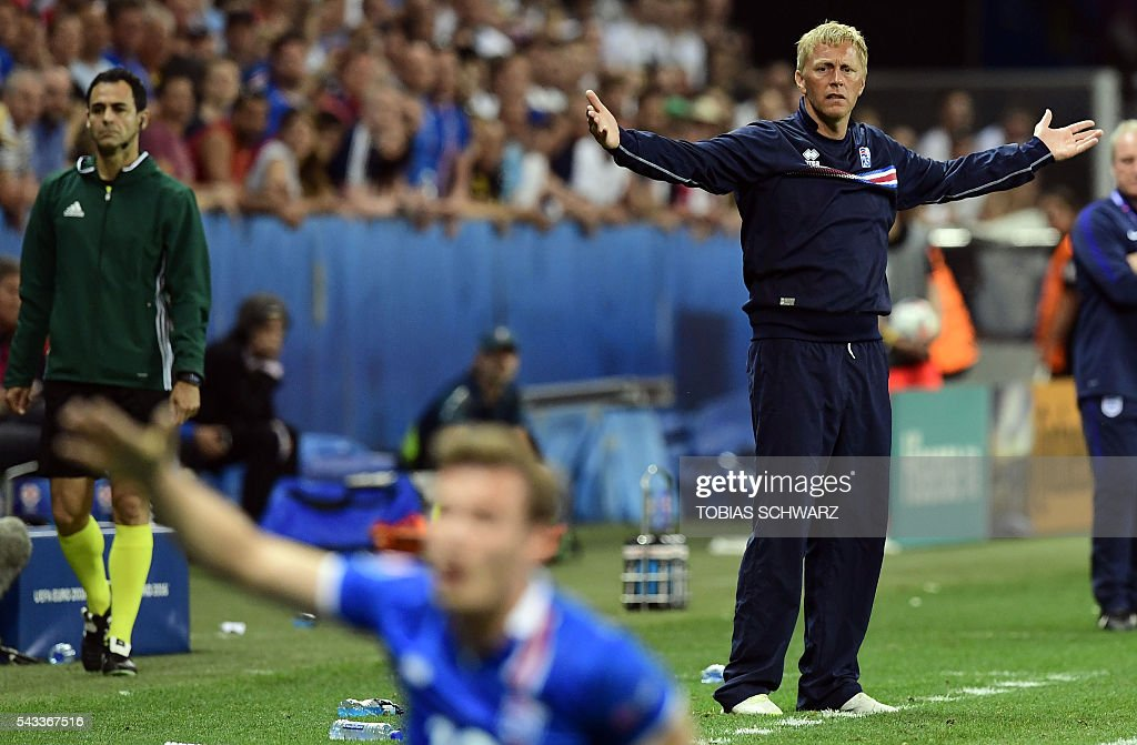 Iceland's coach Heimir Hallgrimsson reacts during Euro 2016 round of 16 football match between England and Iceland at the Allianz Riviera stadium in Nice on June 27, 2016. / AFP / TOBIAS
