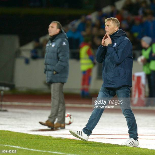 Iceland's coach Heimir Hallgrimsson stands follows the action on the sidelines during the FIFA World Cup 2018 qualification football match between...